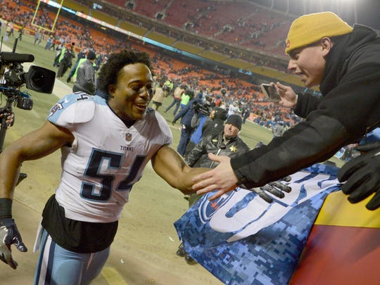 Titans linebacker Avery Williamson (54) celebrates with fans after the team's win over the Chiefs in the AFC Wildcard Game at Arrowhead Stadium Saturday, Jan. 6, 2018 in Kansas City , Mo.