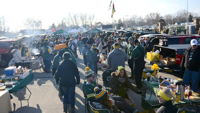 Green Bay Packers fans tailgate before Sunday's game against the Detroit Lions at Lambeau Field.