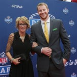 Carson Wentz arrives with his mom Cathy Domres at the Auditorium Theatre of Roosevelt University on Thursday. Wentz was the second-overall pick in the draft.