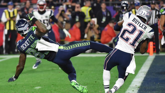 Malcolm Butler (R) of the New England Patriots intercepts a pass intended for Ricardo Lockette (L) of the Seattle Seahawks late in the fourth quarter of Super Bowl XLIX  on February 1, 2015 at University of Phoenix Stadium in Glendale, Arizona.