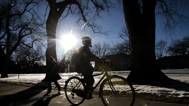 A cyclist makes their way through the Oval on the first day of classes for the spring semester at CSU Tuesday, January 19, 2016.