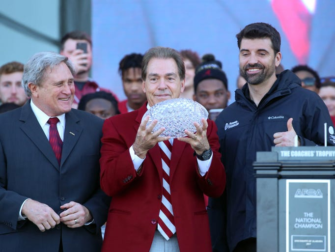 Alabama coach Nick Saban, flanked by Gary Darnell of