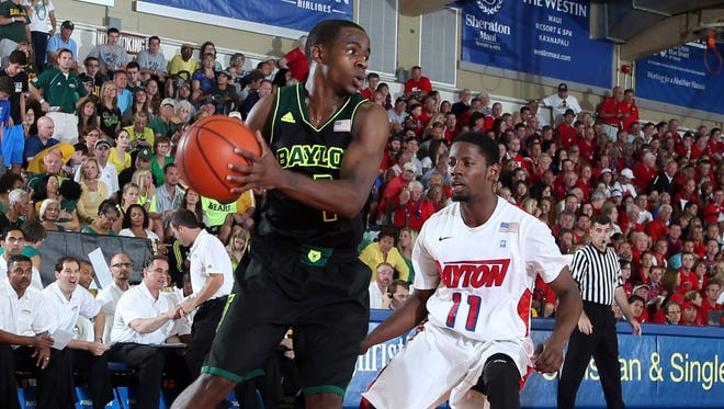 Baylor's Kenny Chery (1) is defended by Dayton guard Scoochie Smith (11) during the second round of the EA Sports Maui Invitational on Tuesday at the Lahaina Civic Center.