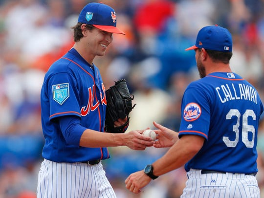 New York Mets starting pitcher Jacob deGrom (48) hands the ball to manager Mickey Callaway (36) as he is relived in the third inning of a spring training baseball game against the Houston Astros, Sunday, March 11, 2018, in Port St. Lucie, Fla.