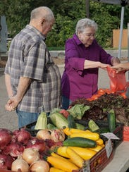 James and Mary Lou Phillips shop for veggies at the