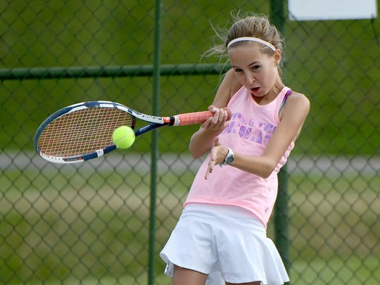 Sophia Henrich hits a forehand in the girls 14 finals of the 84th News Journal/Richland Bank/matchmatetennis.com Tennis Tournament at Lakewood Racquet Club.