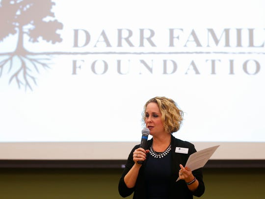 Heather Zoromski, executive director of the ‎Darr Family Foundation, announces a $1,010,000 award to the Community Partnership of the Ozarks Every Child Promise on Friday.