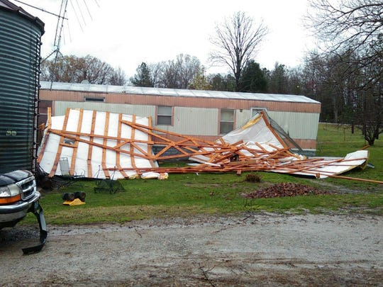 Pieces of a shop roof blocked the front of Beth Smothers' home in Benton County after a tornado touched down Sunday.