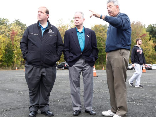 Bill Madden, director of external affairs of SUEZ New York, right, gives a tour to Clarkstown Supervisor George Hoehmann, left, and County Executive Ed Day at the Suez plant at the Lake DeForest Dam in West Nyack on Saturday.
