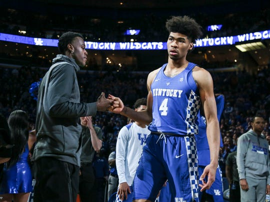 Jarred Vanderbilt, left, greets Nick Richards as he's being introduced at the SEC Championship game March 11, 2018 in St. Louis.