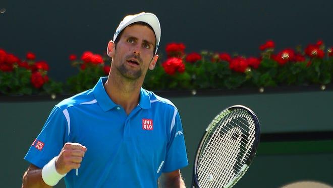 Novak Djokovic (SRB) pumps his fist after defeating Rafael Nadal (ESP) in his semifinal match in the BNP Paribas Open at the Indian Wells Tennis Garden. Djokovic won 7-6, 6-3.