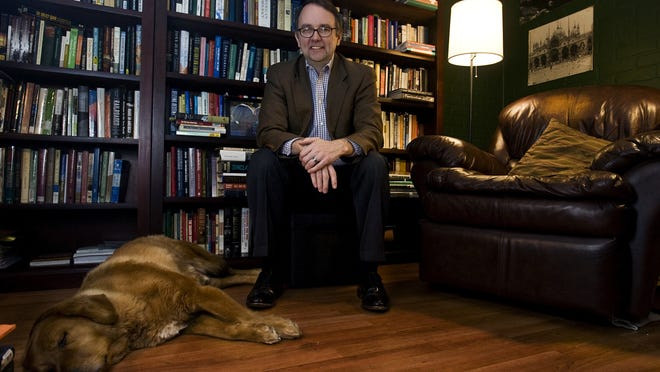 """This 2013 file photo shows Jon Lauck, author of """"The Lost Region: Toward a Revival of Midwestern History,"""" in his home office in Sioux Falls, S.D."""