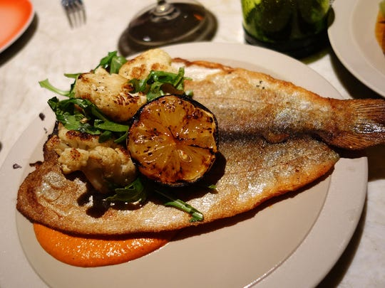 Whole trout from the plancha with grilled lemon, cauliflower and pecan romesco at Weft & Warp Art Bar + Kitchen.