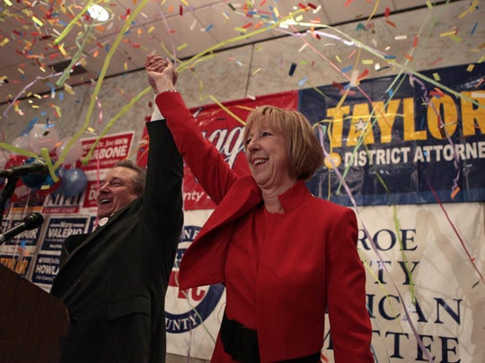 Monroe County Republican Chairman Bill Reilich and newly re-elected County Executive Maggie Brooks celebrate her historic third-term win in 2011.