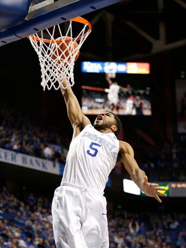 Kentucky Wildcats guard Andrew Harrison (5) lays the