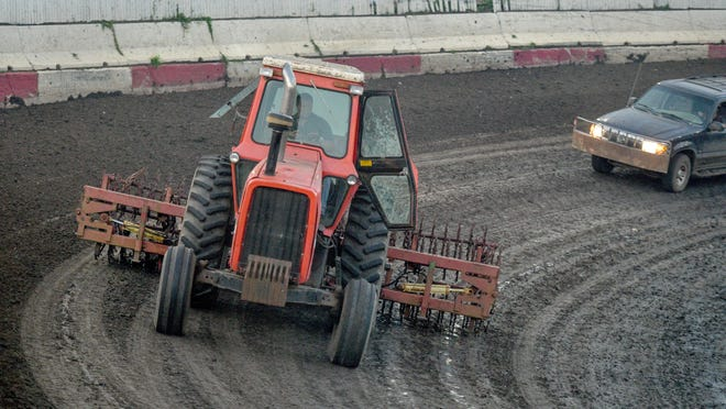 Owner Brandon Dean helps prep the track for racing last year at Peoria Speedway on Farmington Road.