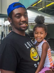 Christopher McGee and his daughter Harmony at the Red Cross Disaster Relief Shelter on Aug. 25, 2016.