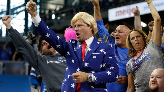 Detroit Lions fan dressed like Donald Trump cheers during the third quarter against the Washington Redskins at Ford Field. Lions won 20-17.