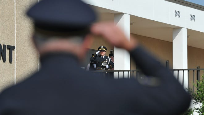 Wichita Falls police detective, Marissa Cervantes, salutes after the playing of TAPS during the Wichita Falls Police Departments annual Police Memorial Service held Monday morning.