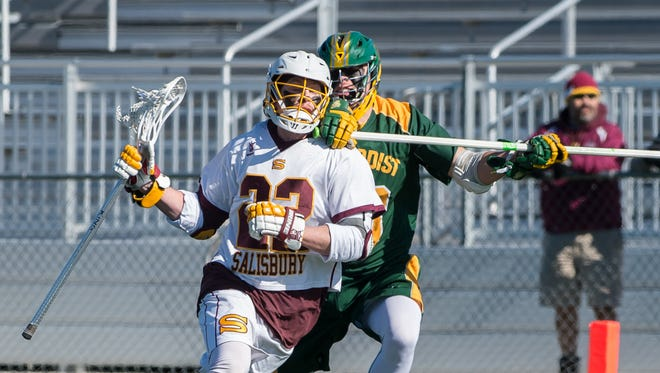 Salisbury University's Nathan Blondino (22) takes a check from Methodist's Daniel Richards (33) during a game at Sea Gull Stadium on Saturday, Feb. 4, 2017.
