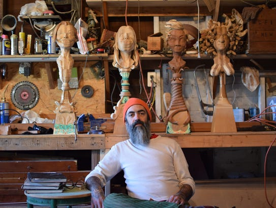 Gary Mellon, photographed with four of his sculptures
