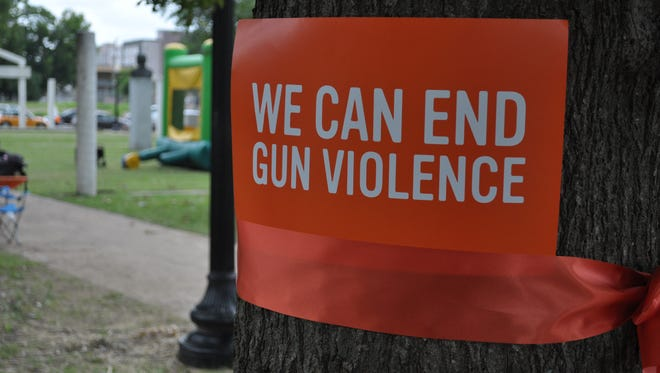 File photo of a sign promoting awareness and prevention of gun violence in Memphis, Tenn.