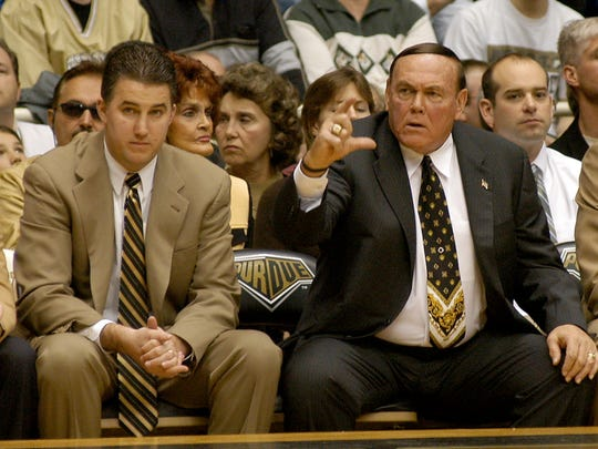 Gene Keady right, and Matt Painter during a 2005 game.
