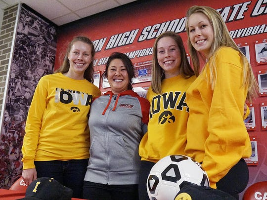 Soccer coach Jeanine Reddy coached all three of the Winters girls. Lindsey Winters is at Olivet, Natalie Winters (second from right) heads for Iowa, and Rachel Winters is at Bowling Green.