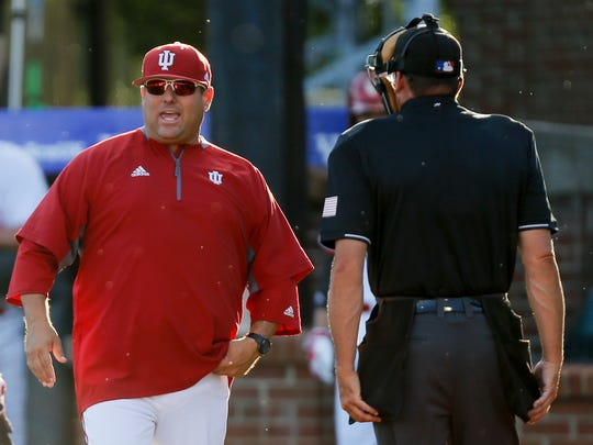 Head coach Chris Lemonis of the Indiana Hoosiers talks with the umpire during the first inning against the NC State Wolfpack during the NCAA Baseball Regional at Cliff Hagan Stadium in Lexington, Kentucky on Friday June 2, 2017.