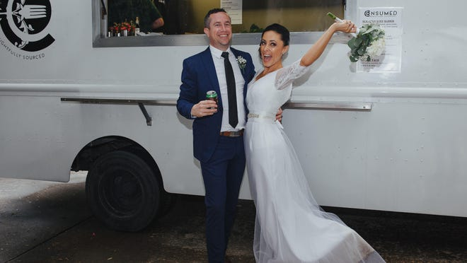 In the March 2017 photo provided by Julie Doniero, Bobby and Angelica Hughes celebrate their Houston wedding with local food truck, Consumed.