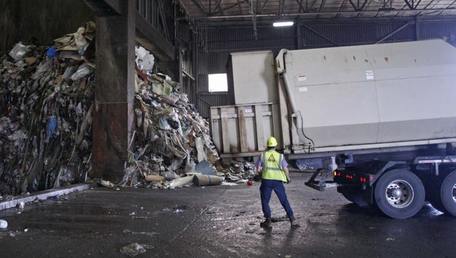 A driver prepares his trailer to dump a load of garbage on the tipping floor at the Covanta Energy facility in Brooks.