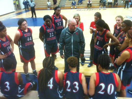 West Monroe coach John Green talks with his team during Thursday's Battle on the Hardwood Classic game with Red River.