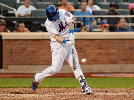 Tomas Nido hits a two-run double Monday