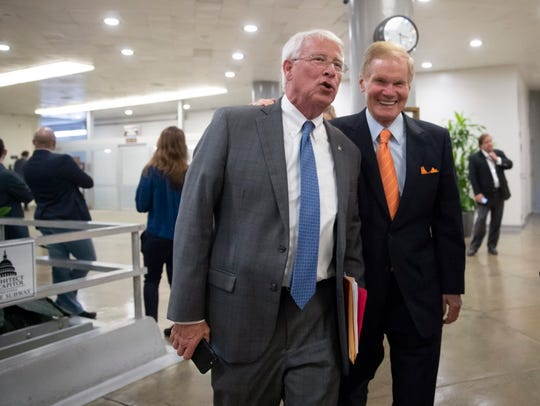 Sen. Roger Wicker, R-Miss., left, and Sen. Bill Nelson,