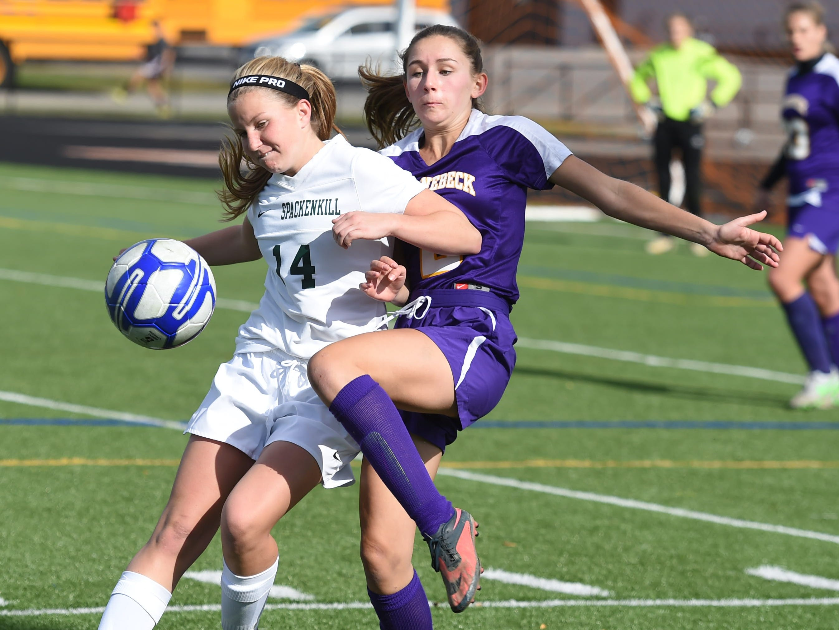 Spackenkill's Katherine Lillis traps the ball away from Rhinebeck's Olivia Lortie during the Section 9 Class C final held in Marlboro on Saturday.