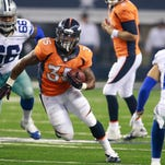 Kapri Bibbs of the Denver Broncos, a record-breaking running back in his one season at CSU, runs through a hole in a preseason game last year at Dallas. Bibbs is hoping to emerge from a crowded backfield and have a breakout year this fall.
