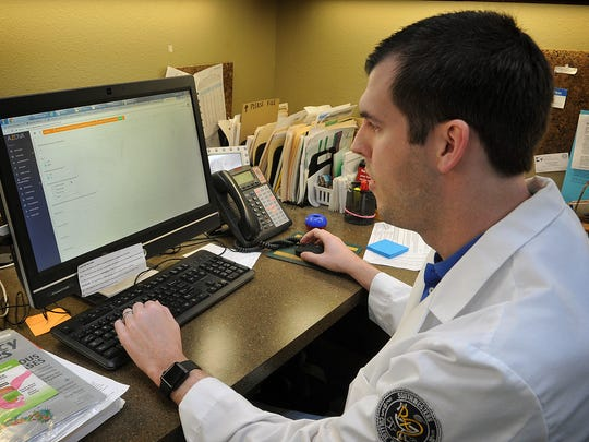 Joe Beard, a pharmacist with Harvest Drug & Gift, looks over the website for a Medication Adherence Program that Harvest and two other local pharmacies are participating in. The program helps patients with hypertension achieve goals in stabilizing blood pressure by adhering to doctor and prescription instructions.