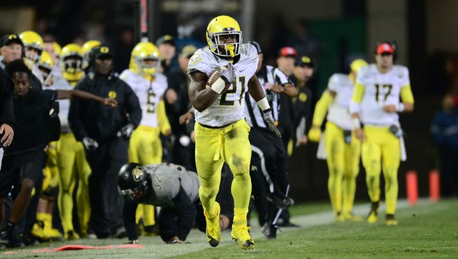 Oct 3, 2015; Boulder, CO, USA; Oregon Ducks running back Royce Freeman (21) carries after a pass reception in the second quarter against the Colorado Buffaloes at Folsom Field. Mandatory Credit: Ron Chenoy-USA TODAY Sports