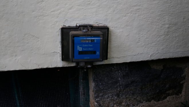 A typical old water meter that required someone to take a reading.