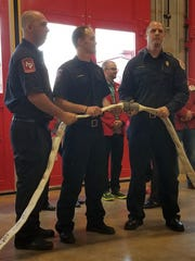 Instead of cutting a ribbon, firefighters uncoupled