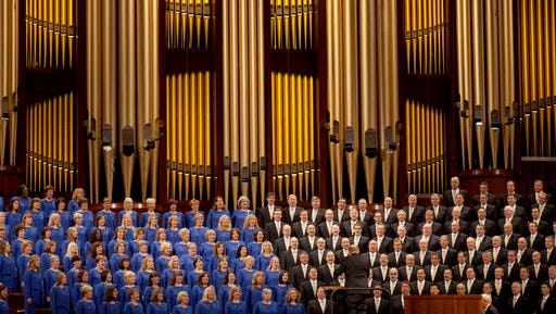 FILE - In this Oct. 3, 2015 file photo, The Mormon Tabernacle Choir sings during the opening session of the two-day Mormon church conference in Salt Lake City.   The church announced on its website Thursday that the 360-member volunteer choir will sing at Trump's swearing-in ceremony on January 20.