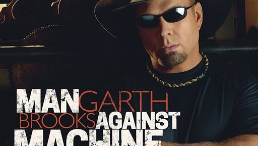 """This CD cover image released by Sony Music Nashville shows """"Man Against Machine,"""" by Garth Brooks. (AP Photo/Sony Music Nashville)"""