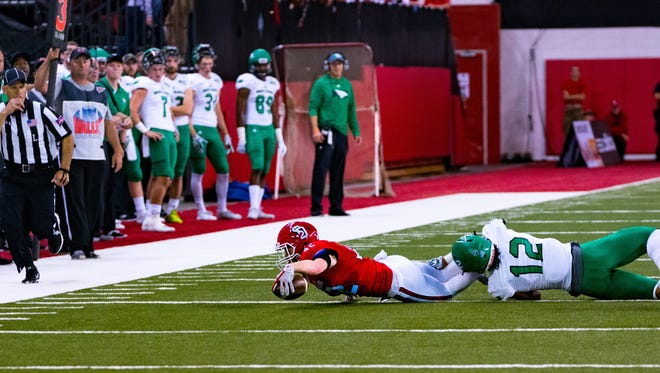 Levi Falck stretches for a first down in the Coyotes' 45-7 win over North Dakota last Saturday.