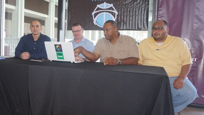 FIBA Oceania regional director David Crocker, second from left, held an introductory press conference at the Sheraton Laguna Guam Resort on Friday. Crocker is helping the Guam Basketball Confederation prepare for an upcoming World Cup and Olympic schedule. He was joined by, from left, men's national team coach E.J. Calvo, Guam Basketball Confederation president Tony Thompson and GBC board member Jon Lujan.