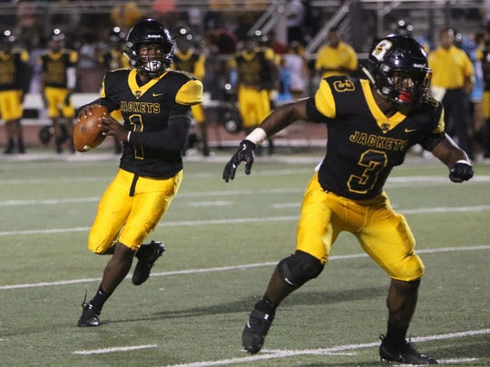 Starkville quarterback Malik Brown looks to pass to his wide receiver Cameron Gardner for a touchdown against the Northwest Rankin Cougars.