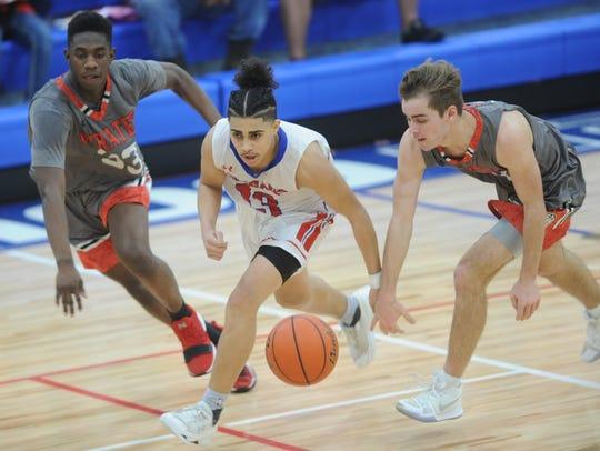 Abilene Cooper's Noah Garcia (13) brings the ball up