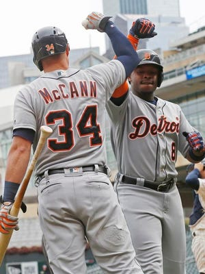 Tigers left fielder Justin Upton, right, celebrates with James McCann after Upton hit a solo home run against Twins pitcher Alex Wimmers during the seventh inning in the first game of a doubleheader Thursday in Minneapolis.