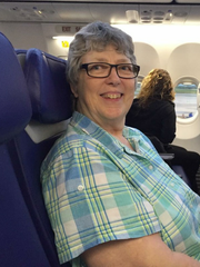 Breast cancer survivor Pamela Banks sits on a plane