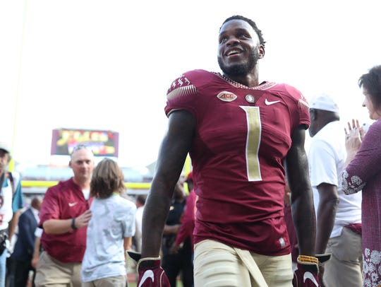 FSU's Levonta Taylor is all smiles after the Seminoles