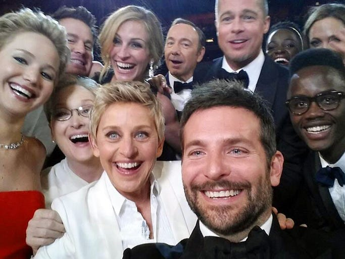 "This image released by Ellen DeGeneres shows actors, front row from left, Jared Leto, Jennifer Lawrence, Meryl Streep, Ellen DeGeneres, Bradley Cooper, Peter Nyong?o Jr. and, second row, from left, Channing Tatum, Julia Roberts, Kevin Spacey, Brad Pitt, Lupita Nyong?o and Angelina Jolie as they pose for a ""selfie"" portrait on a cell phone during the Oscars at the Dolby Theatre on Sunday, March 2, 2014, in Los Angeles."